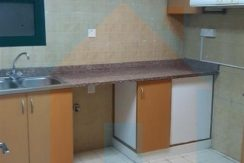 Kitchen view in 1 bhk flat in Rashidiyah towers ajman