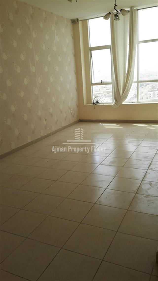 Residential Property for Sale in Almond Towers – Garden City Ajman | 2 Bedroom Hall Flat.