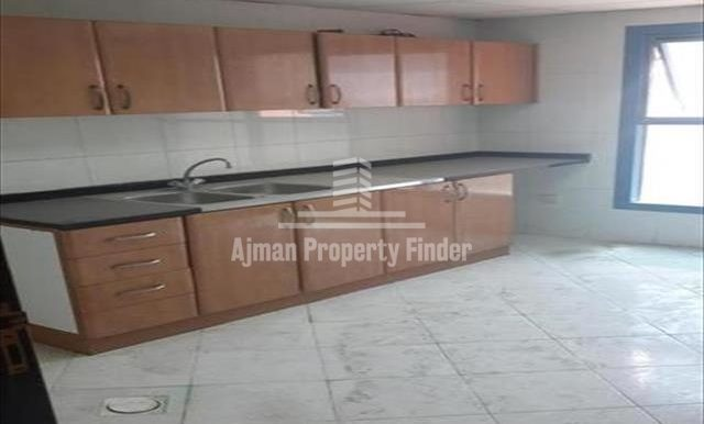 Biz size kitchen with 3 bhk flat in Nuamiyah Towers Ajman