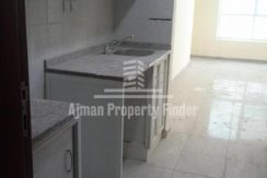 Studio flat in Ajman Pearl Towers - Kitchen and Hall View