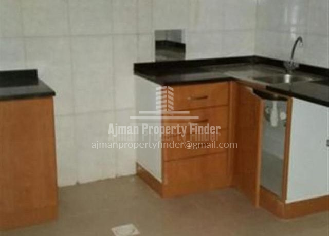 1 bhk Flat in Naumiyah Towers Ajman - Kitchen view
