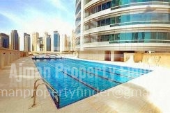 2 BHK flat in Horizon Towers Ajman - Siwmming pool view